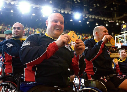 Invictus Games Athletes holding medal at 2014 Invictus Games